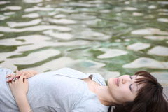 Woman relaxed in a waterside stock image