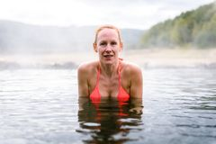 Woman relaxes and enjoys natural hot thermal water roman spa. Outdoor pools and baths with hot, smoking thermal water and hot spring of Aquis Querquennis royalty free stock images