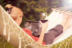 Woman relaxes on a hammock stock photo