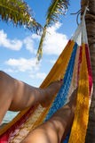 A woman relaxes in a hammock on an Caribbean beach royalty free stock images
