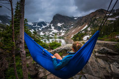 Woman relaxes on a hammock lake Isabelle Colorado Stock Photo