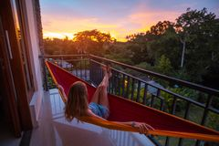 Woman relaxes in the hammock royalty free stock photo