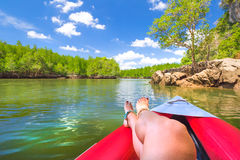 Woman relaxes on Kayak Stock Photo
