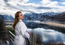 Woman relaxes by looking at a mountain Royalty Free Stock Images