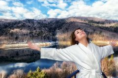 Woman relaxes by looking at a mountain Royalty Free Stock Photography