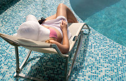 Woman relaxes by the pool Royalty Free Stock Photography