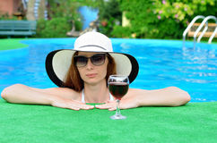 A woman relaxes in the pool. Royalty Free Stock Images