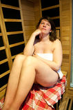 Woman relaxes in sauna Royalty Free Stock Images