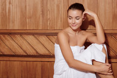 Woman relaxes in a sauna Stock Image