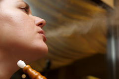 Woman relaxes with shisha Royalty Free Stock Photography