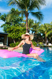 Woman  relaxes  in the swimming pool Stock Photography