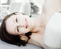 Woman relaxing. With contented smile Royalty Free Stock Images