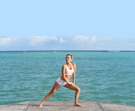 Free Woman Relaxing And Stretching By The Sea Royalty Free Stock Photos - 47990138