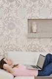 Woman Relaxing And Working At Home Stock Photography