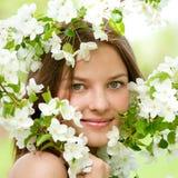 Woman relaxing in apple tree garden Stock Images