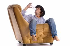 Woman relaxing on armchair Stock Photos