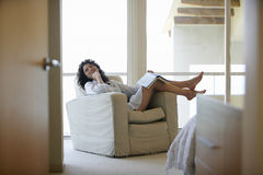 Woman Relaxing On Armchair Royalty Free Stock Photo