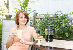 Woman relaxing in backyard Royalty Free Stock Photography