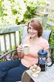 Woman relaxing in backyard Stock Images