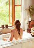 Woman relaxing in the bath Royalty Free Stock Photo