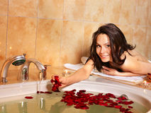 Woman relaxing in bath. Stock Image