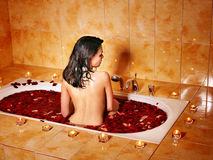 Woman relaxing in bath. Stock Images