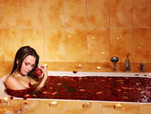Woman relaxing in bath. Royalty Free Stock Image