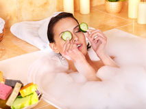 Woman relaxing in bath. Stock Photo