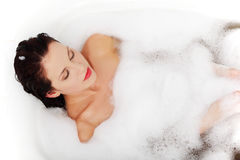 Woman relaxing during the bath. Royalty Free Stock Photography