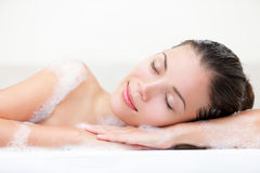Woman relaxing in bath stock photo