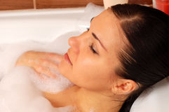 Woman relaxing in bath  Stock Photography