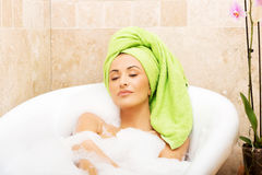Woman relaxing in bath with eyes closed Stock Photo