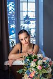 Woman relaxing in bath with flowers, organic skin care, luxury spa hotel, lifestyle photo stock photography