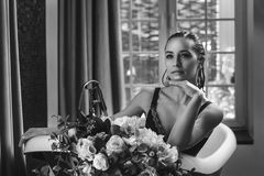 Woman relaxing in bath with flowers, organic skin care, luxury spa hotel, lifestyle photo royalty free stock image