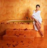 Woman relaxing in bath. Stock Photo