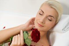 Woman relaxing in bathroom Stock Image