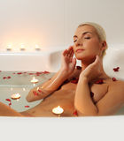 Woman relaxing in bathroom Royalty Free Stock Photos