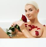 Woman relaxing in bathroom Stock Image