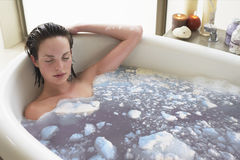 Woman Relaxing In Bathtub stock images