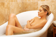 Woman relaxing in bathtub with eyes closed Stock Photo