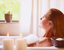 Woman relaxing in bathtub Stock Photos
