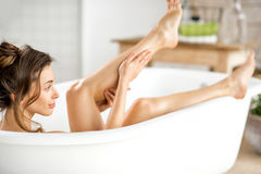 Woman relaxing in the bathtube Royalty Free Stock Image