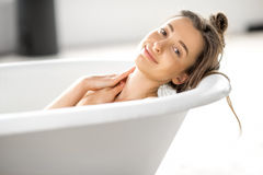 Woman relaxing in the bathtube. Close-up portrait of a young woman relaxing in the bathtube Royalty Free Stock Image