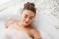 Woman Relaxing In Bathtube With Soap Foam. Lying With Closed Eyes stock image