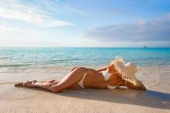woman Relaxing on beach Stock Photos