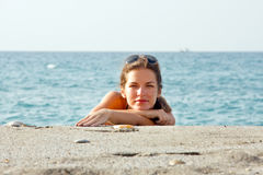 Woman relaxing on the beach. Young woman relaxing on the beach Stock Photography