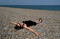 Woman relaxing on beach Royalty Free Stock Photo