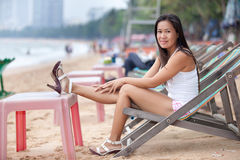 Woman relaxing on beach Royalty Free Stock Images