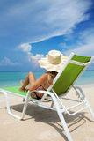 Woman relaxing on a beach Royalty Free Stock Photos