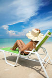 Woman relaxing on a beach Royalty Free Stock Photo